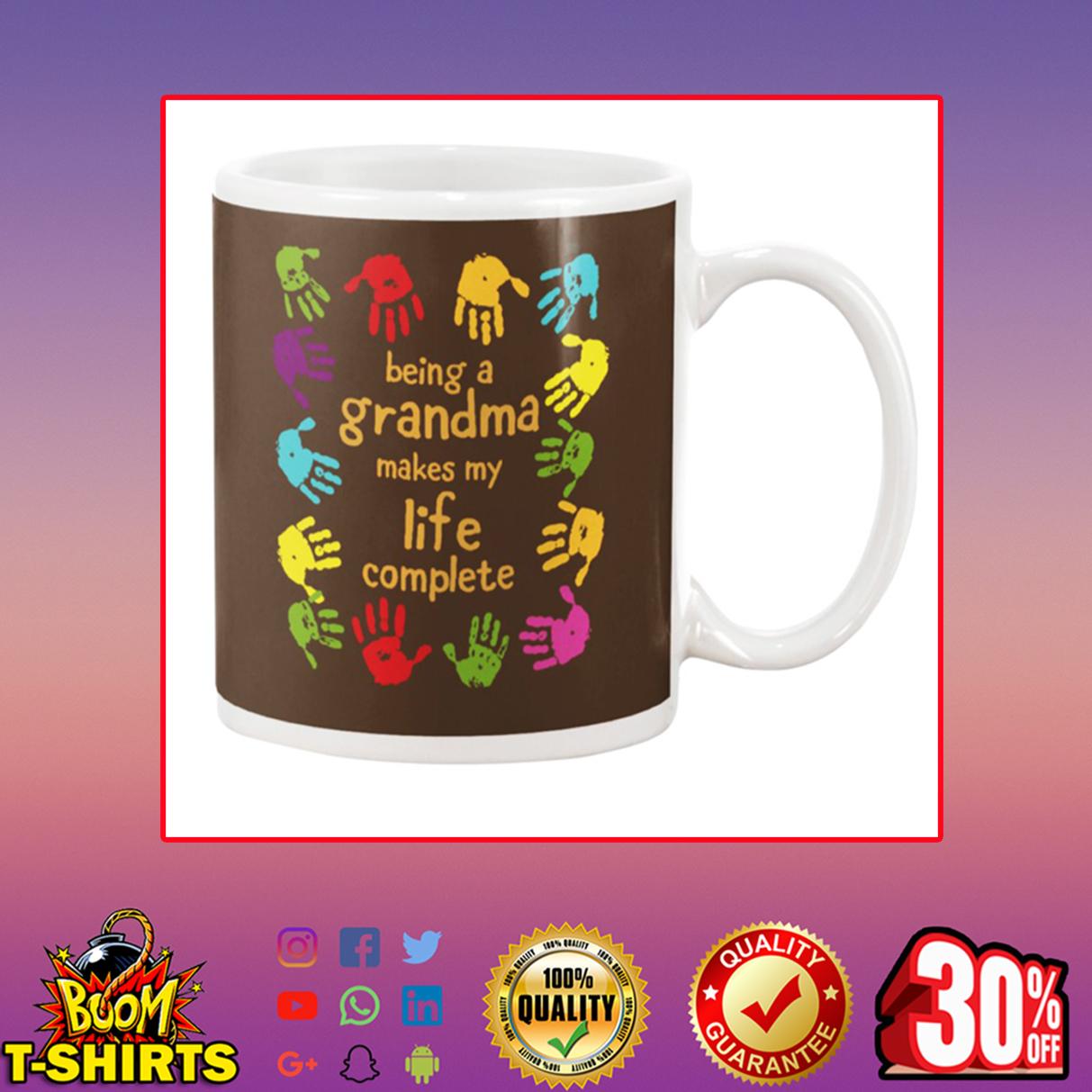 Handprint Being a grandma makes my life complete mug - chocolate